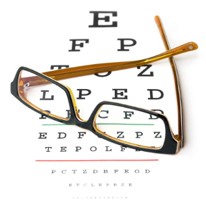 Glasses on eye test chart